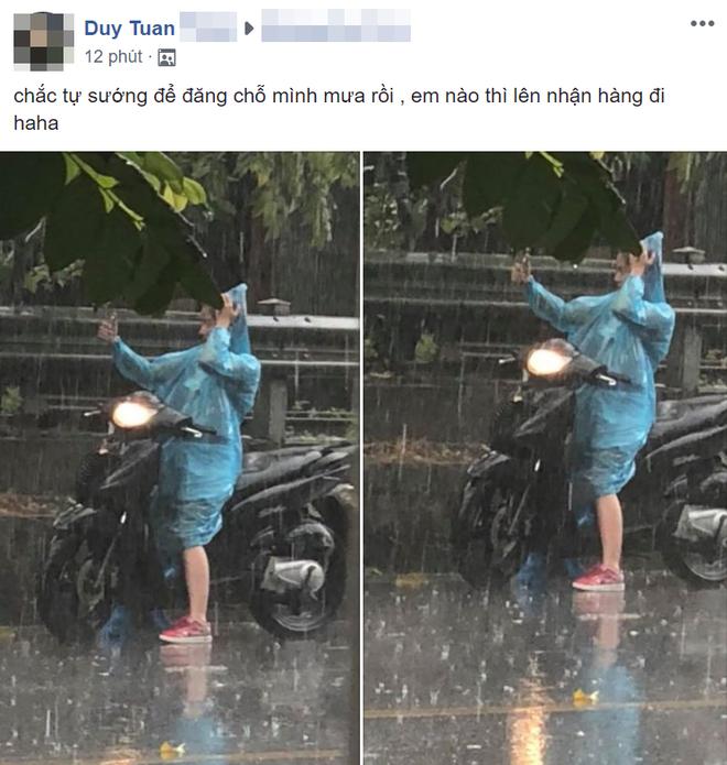 Xuất hiện 10 phút, hơn 1000 bình luận: Bức ảnh độc chỉ có trong cơn mưa Hà Nội chiều nay - Ảnh 1.