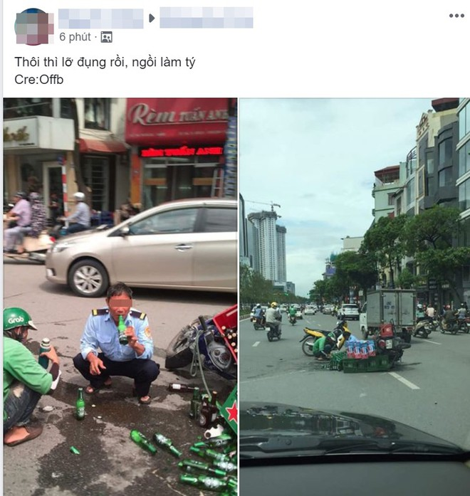 Hành động khó hiểu của người đàn ông cạnh chiếc xe máy vừa gặp tai nạn - Ảnh 1.