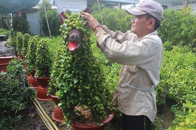 Kiểng hình chú chó lạ mắt giá 4 triệu hút hàng mùa Tết - Ảnh 1.