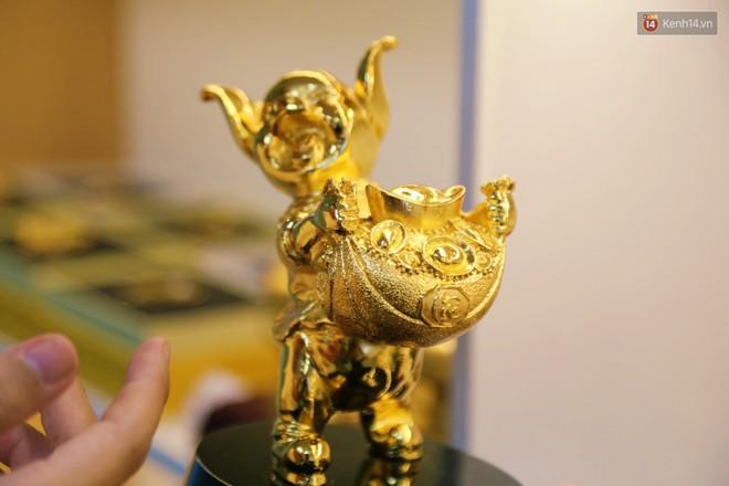 Tượng heo vàng giá hàng trăm triệu đồng được người Sài Gòn săn lùng để chơi Tết Kỷ Hợi 2019 - Ảnh 9.