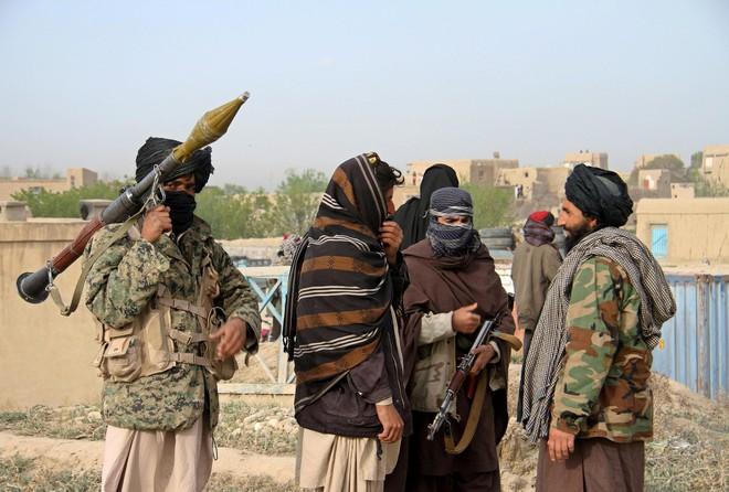 Từ tổ chức khủng bố thành đối tác hoà bình của Mỹ: Taliban nhen nhóm hy vọng cho Afghanistan - Ảnh 2.