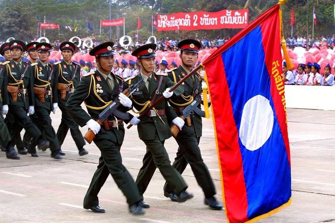 Ai đang giúp Quân đội Lào hiện đại hóa và lột xác chỉ sau một đêm? - Ảnh 1.