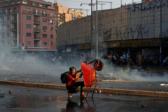 24h qua ảnh: Nông dân Trung Quốc vào mùa thu hoạch ớt - Ảnh 1.