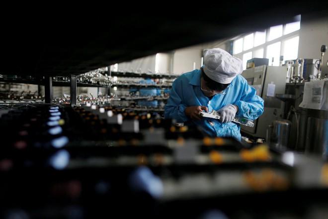 Tăng trưởng u ám, sa thải hàng loạt, doanh nghiệp TQ lo lắng trước mùa đông kinh tế - Ảnh 3.