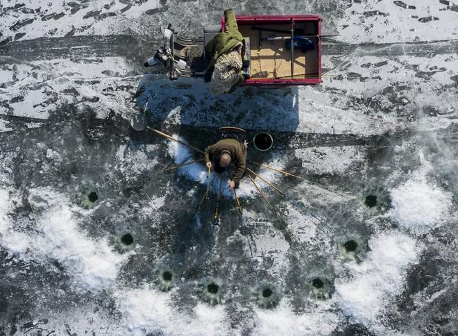 24h qua ảnh: Mật vụ Mỹ đứng gác Nhà Trắng dưới mưa tuyết - Ảnh 5.