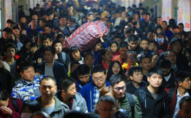 Ảnh: Gian nan hành trình về quê ăn Tết của người Trung Quốc - Ảnh 3.