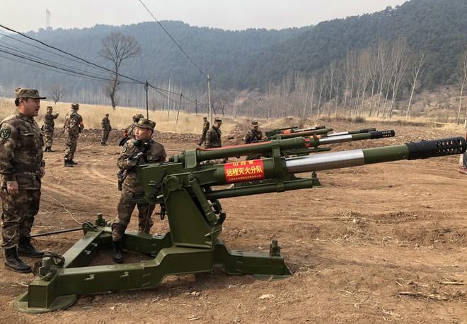 Chuyện có thật! - Chuyên gia Mỹ ngạc nhiên trước cách dùng pháo và xe tăng của Trung Quốc - Ảnh 1.