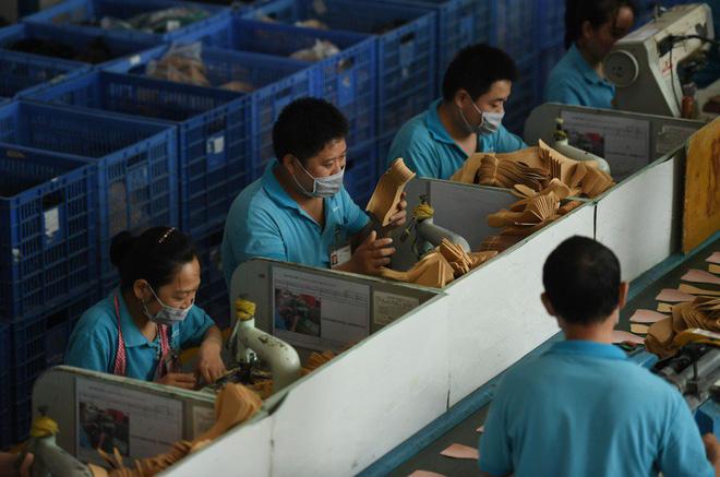 Im thin thít và lặn mất tăm: Cách các doanh nghiệp rời TQ sang Việt Nam tránh bão thương chiến - Ảnh 4.