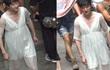 Phùng Thiệu Phong mặc váy ngủ phụ nữ đi lại trên phố