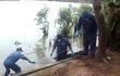 Phát hiện thi thể nữ giới không mặc quần trôi dạt ở biển Cửa Lò