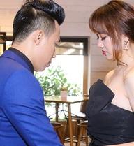 Trấn Thành vô tư chỉnh sửa váy cho Hari Won