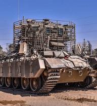 """Xe thiết giáp """"chuồng chó di động"""" của Israel"""