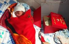 Mang hộp đồ bị bỏ quên trước cổng vào nhà, cán bộ xã ngỡ ngàng vì bên trong là bé sơ sinh