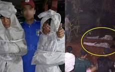 Giả ma dọa dân làng, 2 thanh niên vừa bị bắt ra nghĩa trang nằm ngủ cả đêm cho chừa thói đùa dai
