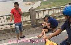 Tai nạn trên cầu Vĩnh Tuy gây xôn xao MXH: Cô gái người dính máu, nắm cổ tay người cứu