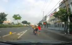 Túm áo đuổi theo tên trộm, cô gái bị kéo lê cả trăm mét trên quốc lộ