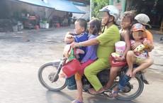 1 người phụ nữ, 5 đứa trẻ và cảnh tượng khiến người ta rùng mình trên phố