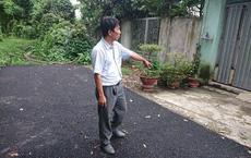 Bỏ tiền túi làm đường, người đàn ông bị còng tay: 'Có hành vi chống người thi hành công vụ'