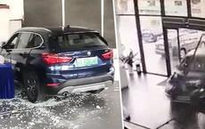 Nhầm chân phanh thành chân ga, nữ tài xế đâm tan tành đại lý BMW