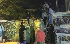 Tài xế ô tô tông xe CSGT rồi leo lên công ty địa ốc nhảy lầu ở Sài Gòn