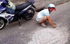 Người đàn ông đục bê tông trên đường chia sẻ việc mình làm