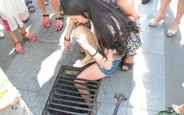 Vừa đi vừa nhắn tin, thiếu nữ bị kẹt chân trong nắp cống