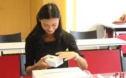 Trường học Trung Quốc tặng sinh viên giỏi Macbook và iPhone 6s