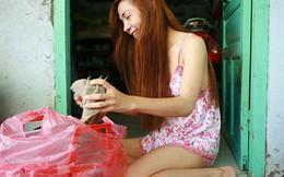 Bộ ảnh cuộc sống của cô gái chuyển giới bán bánh rán gây 'bão mạng'