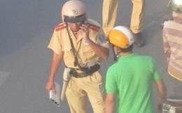 CSGT Hà Nội: Xử lý nghiêm cán bộ nghe điện thoại, xin cho người vi phạm