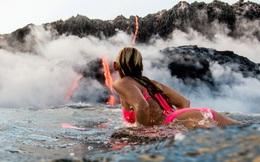 24h qua ảnh: Người đẹp lướt ván sát dòng dung nham núi lửa đỏ rực