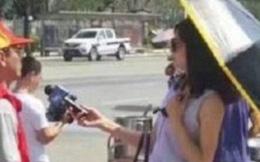 Đeo kính râm, che ô khi phỏng vấn, nữ phóng viên xinh đẹp bị đình chỉ không thương tiếc