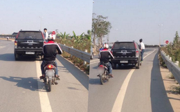Chàng trai đu bám trên xe ô tô gần 10km đường khiến nhiều người sửng sốt