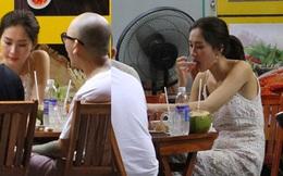 Hoa hậu Thu Thảo diện váy trắng, thoải mái ngồi ăn ốc trên lề đường