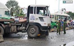 Xe container lùa nhiều phương tiện đang dừng đèn đỏ trên đường