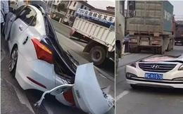 Ô tô bị container chở sỏi đè dẹp lép, tài xế thoát chết một cách thần kỳ