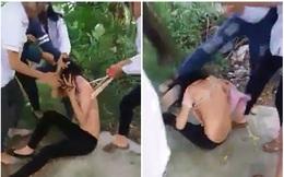 Nữ sinh cấp 3 bị bạn đánh hội đồng, xé áo trước cổng trường