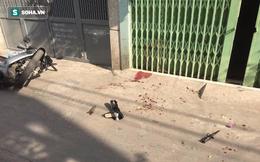 Gã hàng xóm cầm dao đứng chờ trước cổng, chém cụ bà tử vong