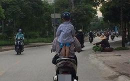 Hình ảnh nguy hiểm trên phố Hà Nội và ánh mắt của người mẹ khiến dân mạng bức xúc