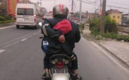Ông bố vừa lái xe vừa ôm con phía sau khiến người dưng cũng phải lên tiếng