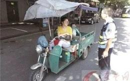 Bà mẹ trẻ nổi tiếng vì vừa lái xe ba gác, vừa cho con nhỏ bú ngay giữa đường phố