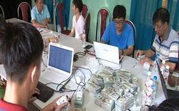 Bắt đối tượng người Trung Quốc vận chuyển gần 1 triệu USD qua biên giới