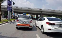 Cuộc chiến taxi: Có thể tịch thu những xe đã dán biểu ngữ?