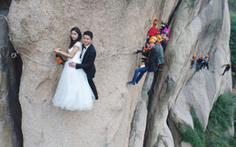24h qua ảnh: Cặp đôi mạo hiểm chụp ảnh cưới trên vách núi dựng đứng