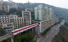 24h qua ảnh: Đường tàu điện chạy xuyên qua tòa chung cư 19 tầng