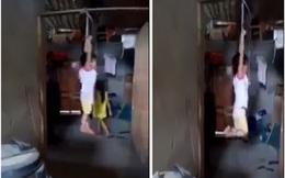 Xác minh đoạn video bé gái bị cột tay treo trên xà nhà