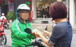 Phải đội mũ bảo hiểm ướt, cô gái đã có hành động không ngờ với tài xế Grabbike