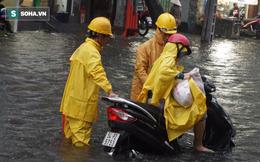 Cơn mưa lớn lại khiến đường phố Sài Gòn biến thành sông
