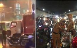 2 chiến sĩ CSGT phát áo mưa cho người Sài Gòn và bác tài xe rác tặng áo mưa cho anh công an: Vòng tròn của những điều tử tế