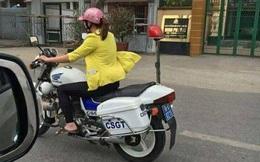 Điều tra hình ảnh người phụ nữ mặc thường phục, đi dép lê lái xe đặc chủng