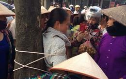 Một phụ nữ bị trói vào gốc cây ở Vĩnh Phúc